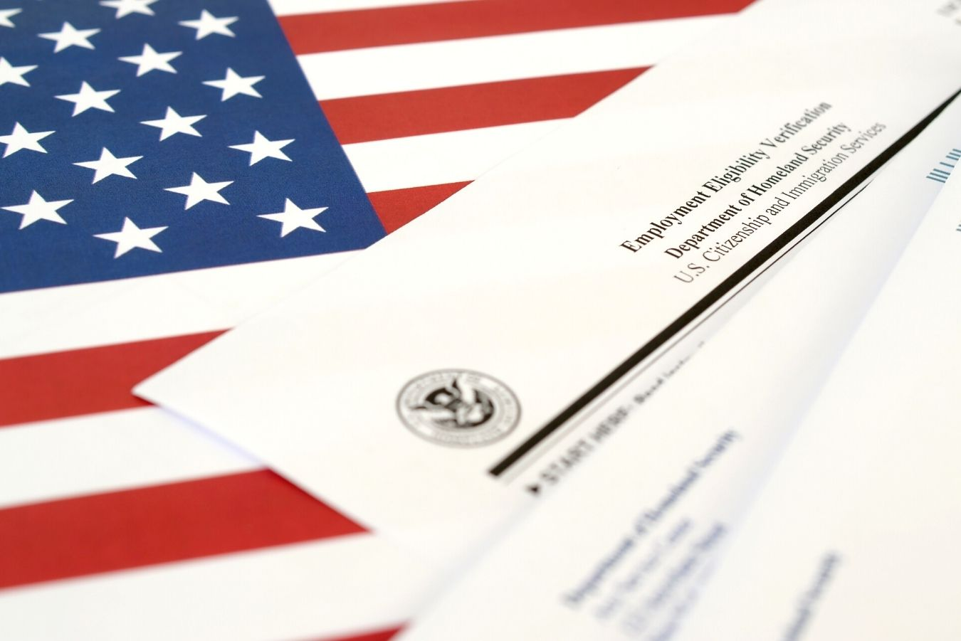 Several IRS forms w/ an American flag in the background